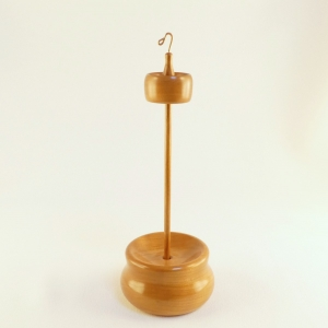 Top whorl drop spindle set with a matching holder display storage stand. The high whorl is rim weighted and notched for an easy long spin. Includes a hand turned spindle shaft all wood used is cherry. One of a kind heirloom quality functional art by Cynthia D. Haney
