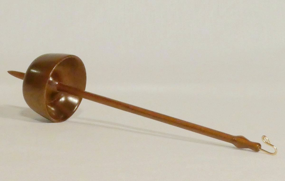 Black Walnut bottom whorl drop spindle, spins as a support spindle too. Rim weighted for a long duration spin handmade by Cynthia D. Haney a woman woodturner in Virginia, USA.