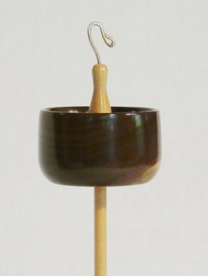 Top whorl drop spindle with a spectacular rim weighed notched black walnut whorl on a hand turned maple shaft and bronze hook. One of a kind heirloom quality functional art by Cynthia D. Haney