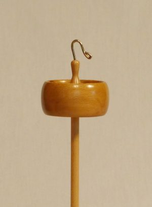 One of a kind Sycamore and Maple top whorl drop spindle with a bronze hook. Designed with a rim weighted, notched whorl for easy to learn how to spin by Cynthia D. Haney