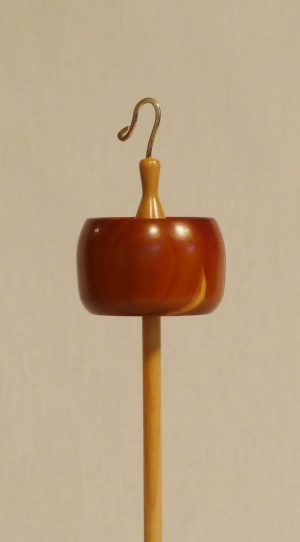 Eastern Red Cedar and Maple Top Whorl Drop Spindle handmade by Cynthia D. Haney whorl is notched and rim weighted with a hook. Spectacular functional art.