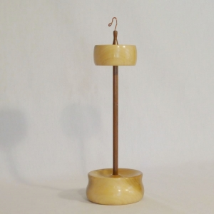 Tulip Poplar and Black walnut top whorl drop spindle set with a base holder display stand. Designed and handmade by Cynthia D. Haney for a rim weighted long duration spin.