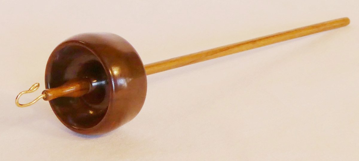 Branch size top whorl drop spindle in black walnut signed number 342 by Cynthia D. Haney