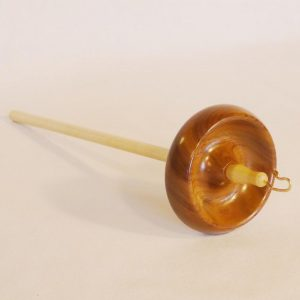 Large heavy trunk size top whorl drop spindle in Black walnut on maple woods and a bronze hook. Rim weighted whorl with a notch. Designed and handmade by Cynthia D. Haney