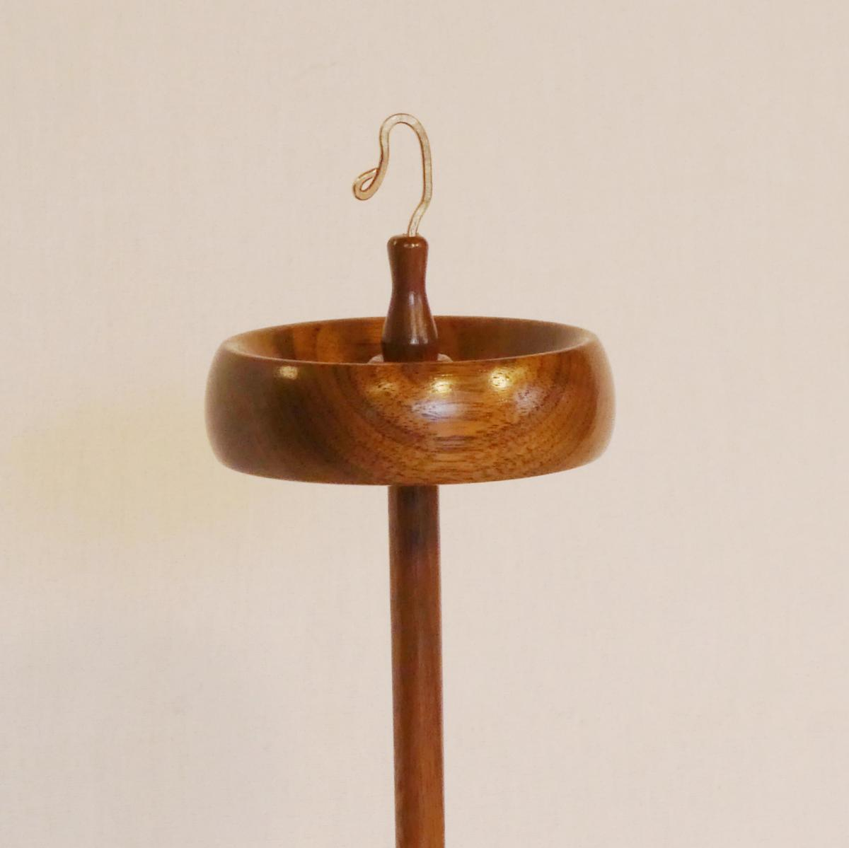 Spindle 367 a trunk size top whorl drop spindle designed and turned by Cynthia D. Haney from black walnut wood. With a jewelry quality bronze hook.
