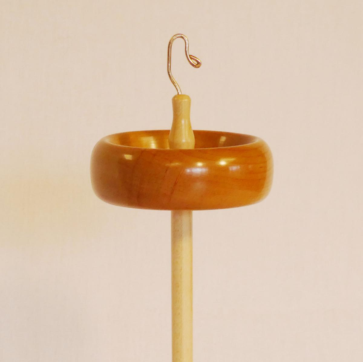 Trunk size top whorl drop spindle in cherry on maple handmade by Cynthia D. Haney signed number 368