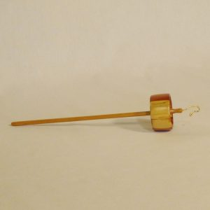 Spectacular Eastern Red Cedar on Cherry Top whorl drop spindle. The high whorl is rim weighted and has a notch, hook is bronze. Designed and handmade by Cynthia D. Haney