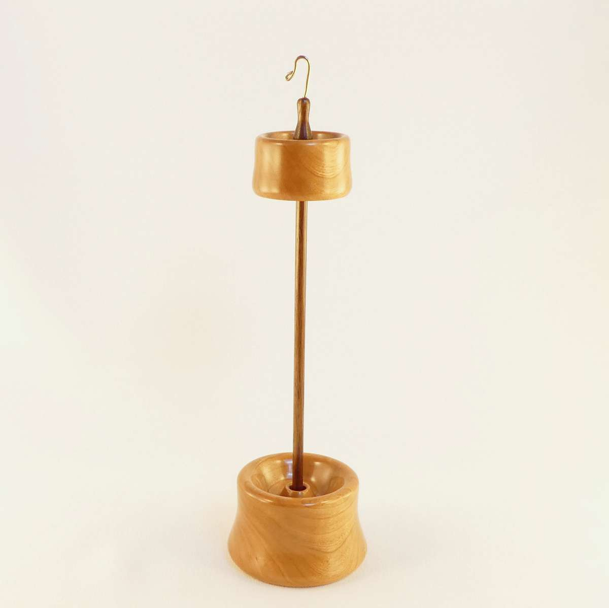 One of a kind handmade high whorl suspended spindle for spinning yarn from wool with matching display storage stand. Woods include Cherry and Black Walnut luxury heirloom quality finish and design by Cynthia D. Haney