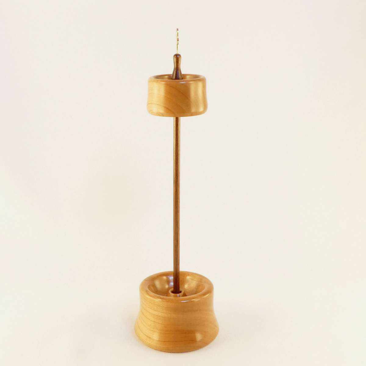 Cherry and Black Walnut Top Whorl Drop Spindle with matching display stand in Cynthia D. Haney's branch size. Handmade in Virginia USA