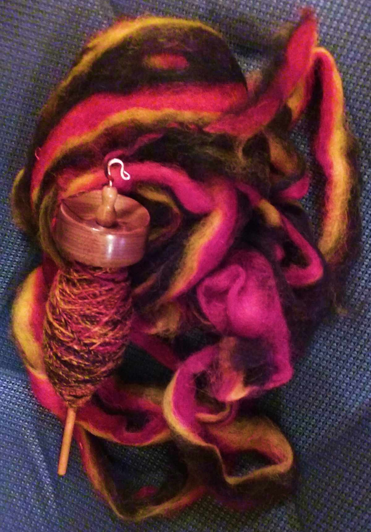 The roving that was spun for this tutorial along with the high whorl suspended spindle used for spinning one single of what will be this two ply.  Wool and alpaca fiber blend in the US spindle made in Virginia by Cynthia D. Haney of Cynthia Wood Spinner.
