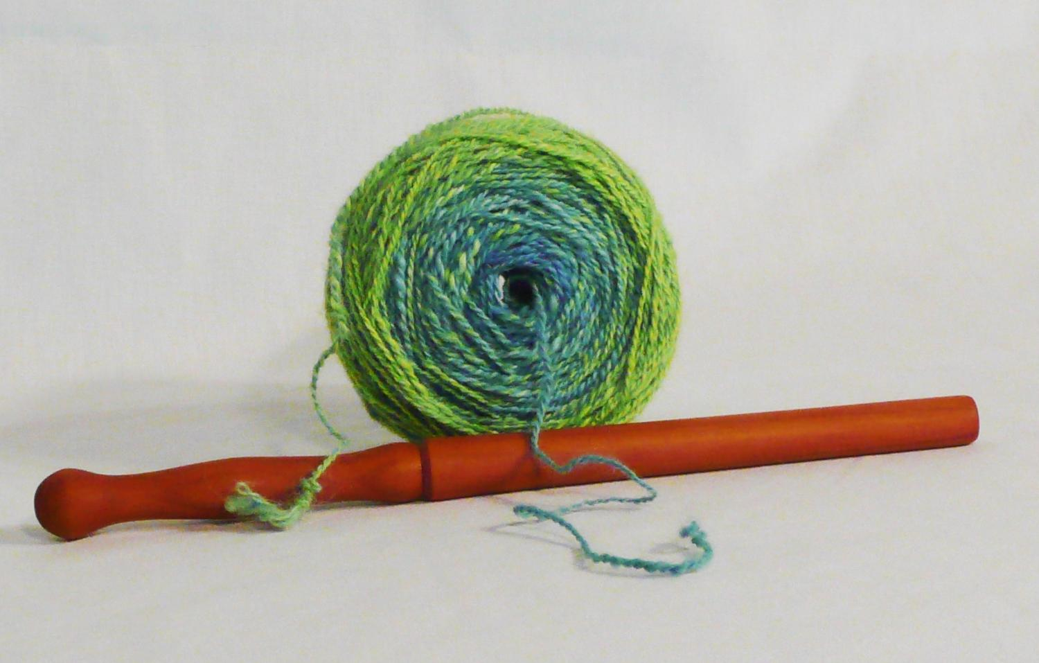 ow to use a nostepinne the tool and the result a tangle free center feed yarn ball.  Featuring a cherry wood hand turned ball winding stick hand made by Cynthia D. Haney.